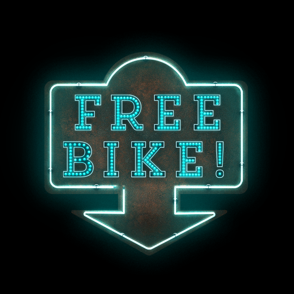 a neon light that reads 'free bike'